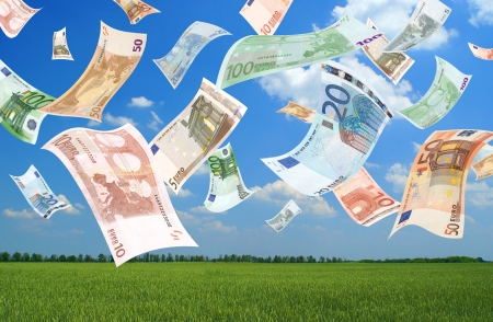 abundance money: Falling euros (field background)