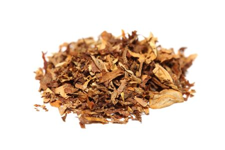 Close up view of spilled tobacco pile isolated on white background with shadow Stock Photo