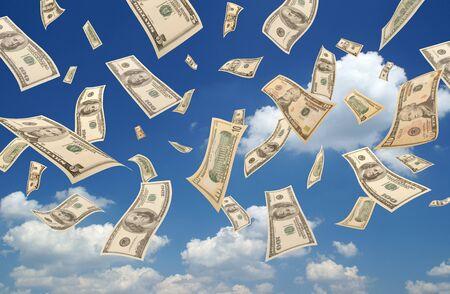 Falling dollars (sky background) Stock Photo