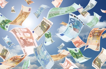 Falling euros (sunny sky background)