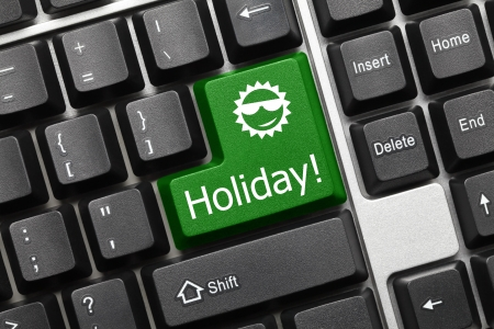 holiday: Close up view on conceptual keyboard - Holiday (green key)