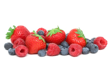Strawberries, raspberries and blueberries isolated on white background