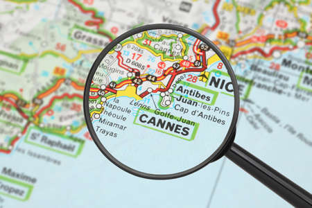 Tourist conceptual image  Destination - Cannes  with magnifying glass Stock Photo - 16494234