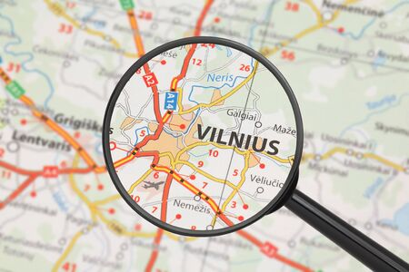 Tourist conceptual image  Destination - Vilnius  with magnifying glass  Stock Photo - 16494233