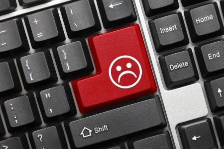 Close up view on conceptual keyboard - Bad mood red key Reklamní fotografie