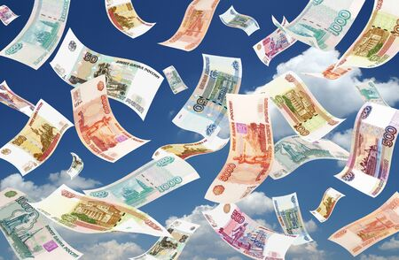 roubles: Falling Roubles on sky background. Conceptual business image.