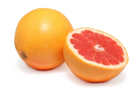 Ripe grapefruits isolated on white background with shadows