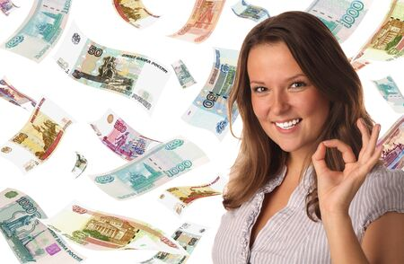 roubles: Portrait of smiling girl indicating ok sign on falling roubles background Stock Photo