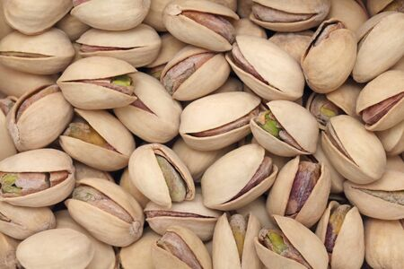 nutshells: Background make from salt pistachios (into nutshells)