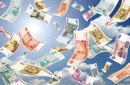 roubles: Falling Roubles on sunny sky background  Conceptual business image