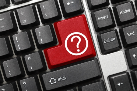 question concept: Close up view on conceptual keyboard - Question mark  red key  Stock Photo
