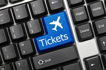 Close up view on conceptual keyboard - Tickets  blue key with aeroplane symbol