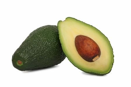One full and half avocado isolated on white background photo