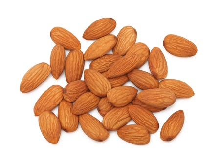 Stack of almonds isolated on white background photo