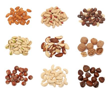 Piles of different nuts  groundnut, pistachio, hazelnut, almond, peanut, walnut, cashew, chestnut, cedarnut and brazil  collection isolated on white background Stock Photo