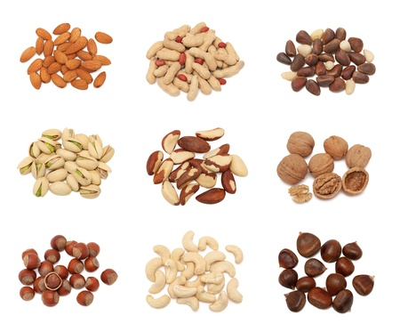 cashew nuts: Piles of different nuts  groundnut, pistachio, hazelnut, almond, peanut, walnut, cashew, chestnut, cedarnut and brazil  collection isolated on white background Stock Photo