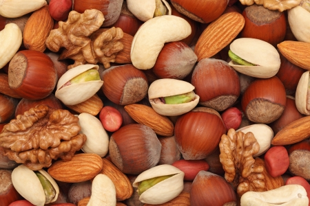 cashew nuts: Natural background made from different kinds of nuts Stock Photo
