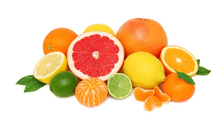 Pile from different citrus fruits isolated on white background photo