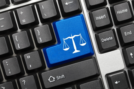 information technology law: Close up view on conceptual keyboard - Law symbol (blue key) Stock Photo