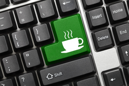 Close up view on conceptual keyboard - Coffee cup (green key) photo