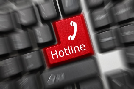 tecla enter: Cierre plano en el teclado conceptual - Hotline (tecla roja). Efecto de zoom Foto de archivo