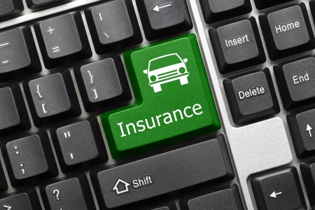 Close up view on conceptual keyboard - Insurance (green key with car icon)
