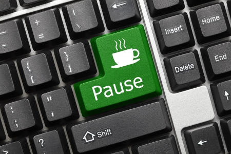 Close up view on conceptual keyboard - Pause (green key) photo