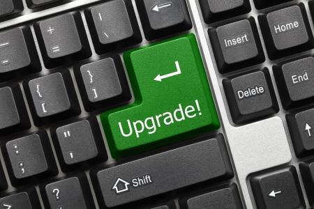 modernization: Close up view on conceptual keyboard - Upgrade (green key)