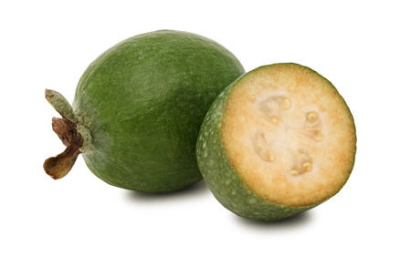 One whole and a half feijoa isolated on white background photo