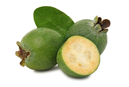 Ripe feijoa with green leaf isolated on white background photo