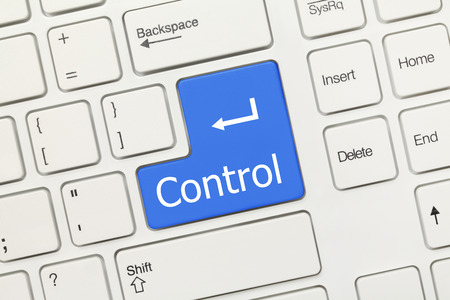 Close-up view on white conceptual keyboard - Control (blue key) photo