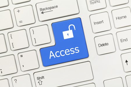 Close-up view on white conceptual keyboard - Access (blue key) photo
