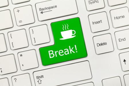 Close-up view on white conceptual keyboard - Break (green key) photo