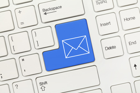 Close-up view on white conceptual keyboard - Mail icon (blue key) photo
