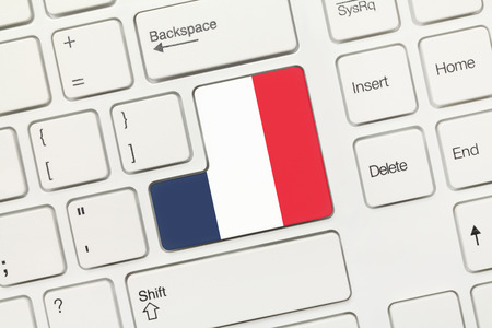 Close-up view on white conceptual keyboard - France (key with flag) photo