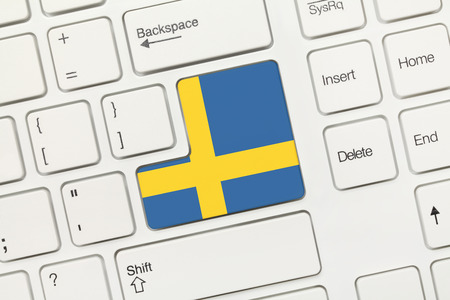 suomi: Close-up view on white conceptual keyboard - Sweden (key with flag)