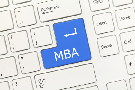 mba: Close-up view on white conceptual keyboard - MBA (blue key)