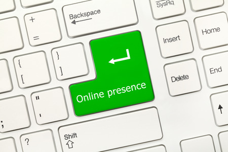 online internet presence: Close-up view on white conceptual keyboard - Online presence (green key)