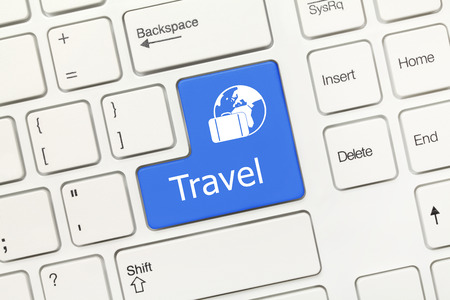 Close-up view on white conceptual keyboard - Travel (blue key) photo