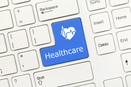 Close-up view on white conceptual keyboard - Healthcare (blue key) photo