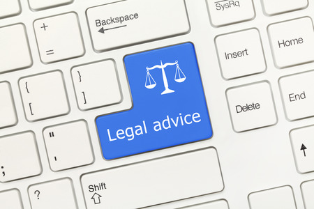 Close-up view on white conceptual keyboard - Legal advice (blue key) photo
