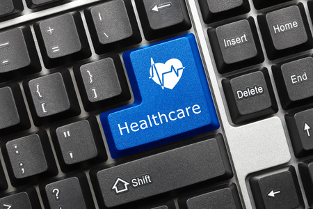 Close-up view on conceptual keyboard - Healthcare (blue key) photo