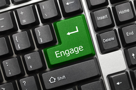 Close-up view on conceptual keyboard - Engage (green key) Stock Photo