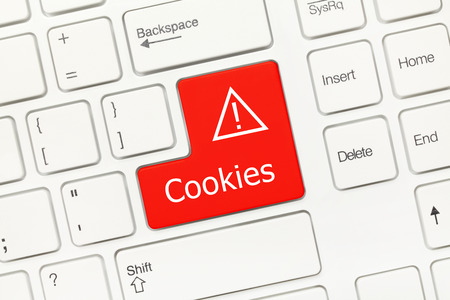 Close-up view on white conceptual keyboard - Cookies (red key)