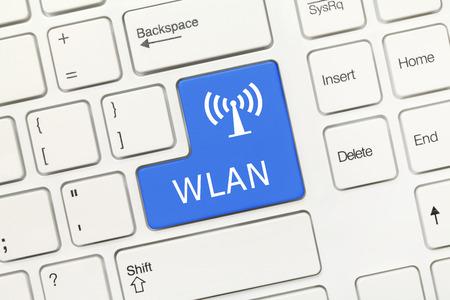 wlan: Close-up view on white conceptual keyboard - WLAN (blue key)
