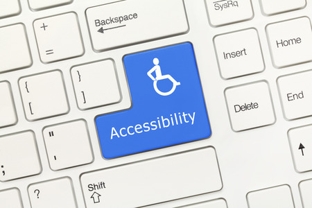 Close-up view on white conceptual keyboard - Accessibility (blue key)
