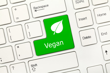 dietology: Close-up view on white conceptual keyboard - Vegan (green key) Stock Photo