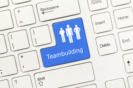 teambuilding: Close-up view on white conceptual keyboard - Teambuilding (blue key)