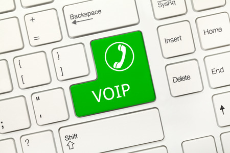 voip: Close-up view on white conceptual keyboard - VOIP (green key)
