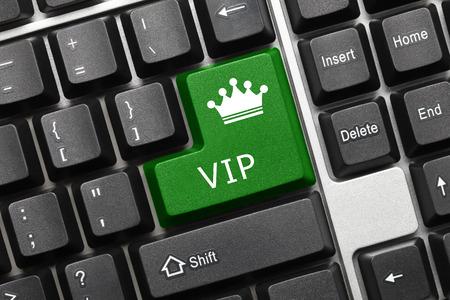 Close-up view on conceptual keyboard - VIP (green key)